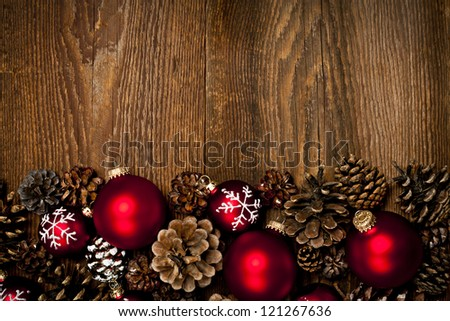 Rustic wood background with Christmas ornaments and pine cones