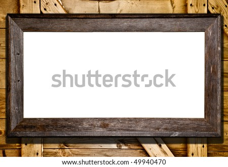 Rustic wood frame against barn door or wood panel background. Blank white template for your text or image. - stock photo