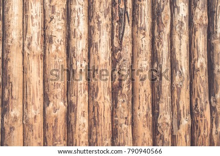 Rustic wooden background of logs - a wooden fence