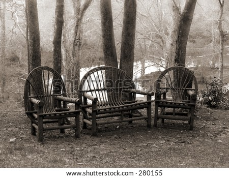 rustic wooden furniture in  the woods - stock photo