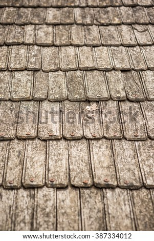 Rustic wooden roof tile background - stock photo