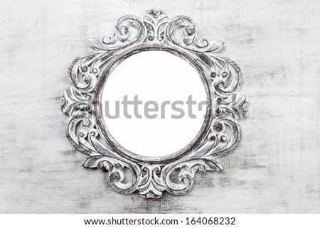 Rustic wooden round frame on grey background. Copy space, your text here - stock photo