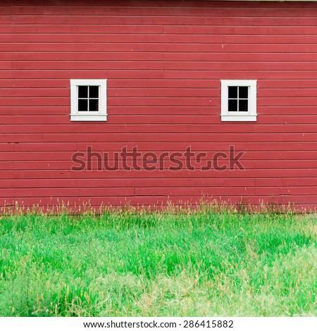 Rustics windows in a red barn rural of Palouse, Whitman County, Washington State, USA. - stock photo