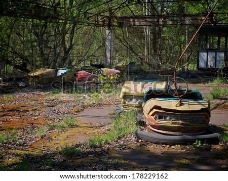 Rusting derelict bumper cars at Pripyat, Chernobyl, Ukraine - stock photo