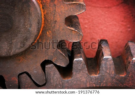 rusty and metallic gear wheel of old industry - stock photo