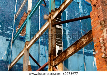 Rusty beams and columns at construction site - stock photo