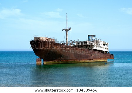 rusty boat stranded on the shore in Lanzarote, Canary Islands, Spain - stock photo