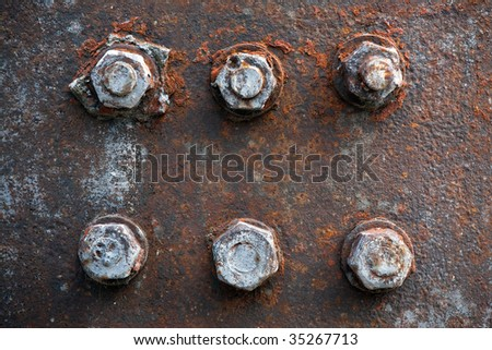 Rusty bolts and nuts on an old machinery - stock photo