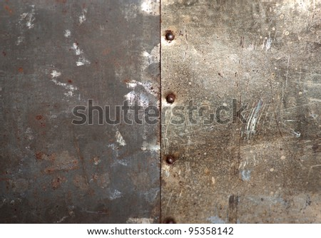 Rusty bolts on grunge metal background - stock photo