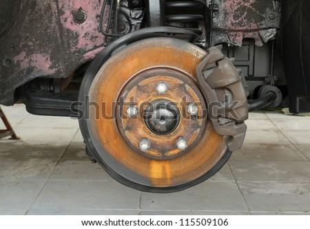 Rusty car brake wait for service in the garage - stock photo