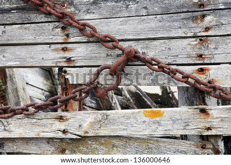 Rusty chain. Abandoned old boat detail. Old rusty chain .