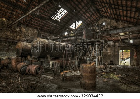 Rusty cisterns and barrels in an abandoned factory, HDR processing - stock photo
