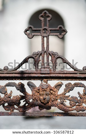 Rusty cross with decorated angel's head - stock photo