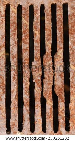 rusty drain hole - stock photo
