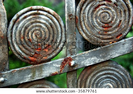 Rusty fence detail - stock photo