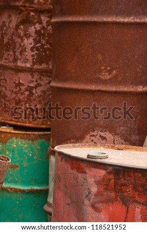 Rusty fuel and chemical drums, corroded barrel pile. - stock photo