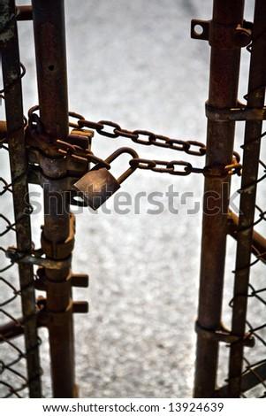 Rusty gate and lock - stock photo