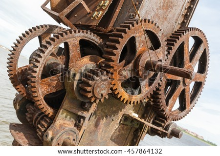 rusty gears and winch mechanism in Fort Alexander Chumnoy in the Gulf of Finland
