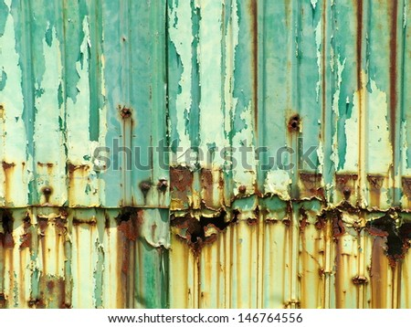 Rusty green painted metal wall with cracked paint, texture color