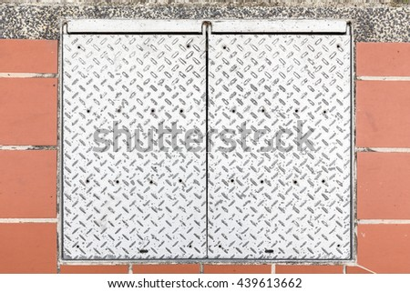 Rusty, grunge manhole cover - stock photo