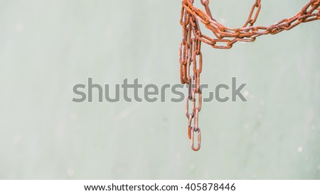 Rusty hanging chains on the background - color toned image - focus on hanging lower chains - stock photo