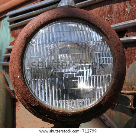 Rusty Headlight - stock photo