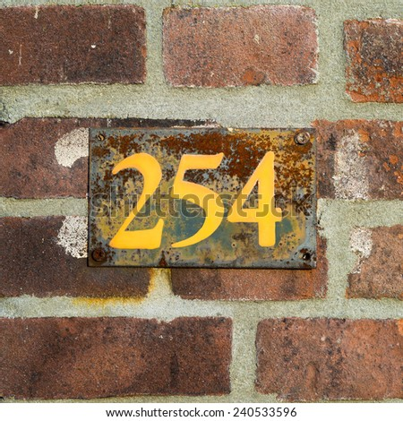 rusty house number two hundred and fifty four - stock photo