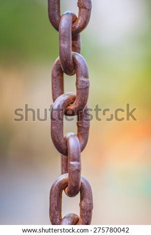 Rusty iron chain hanging down - stock photo