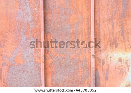 Rusty iron gates that had been left to decay of a house in the city. rusty white iron plate. abstract background texture - stock photo