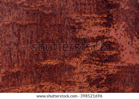 Rusty iron surface old red grunge sheet of iron fragment of protective structure made of metal plate  closeup on armor textured background - stock photo