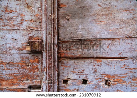 Rusty keyhole in a wooden door. Processed for hdr tone mapping effect - stock photo
