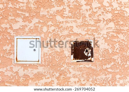 Rusty metal door ventilation duct on the abstract concrete wall. Grungy Concrete Surface. Great background or texture. - stock photo