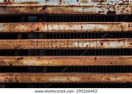 Rusty metal on the grill from the front of a truck - stock photo