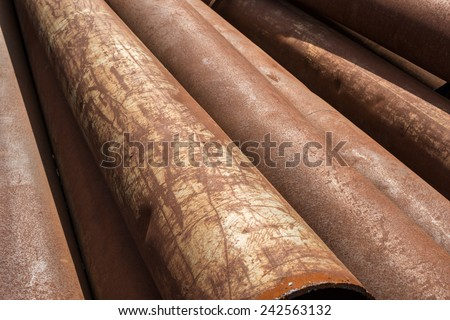 Rusty metal pipes stack on the construction site.