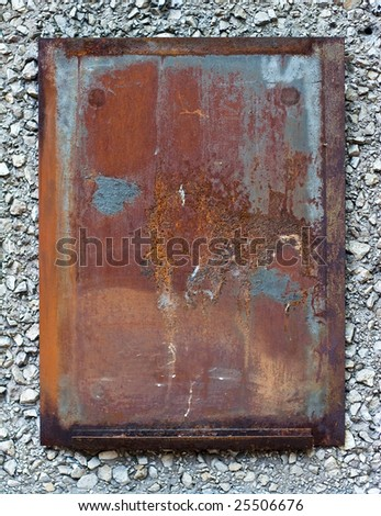 Rusty Metal Plate on Stone Wall - stock photo