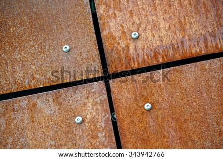 rusty metal plates as facade design - stock photo