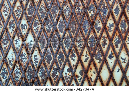 Rusty metal texture or background with diamond pattern - stock photo