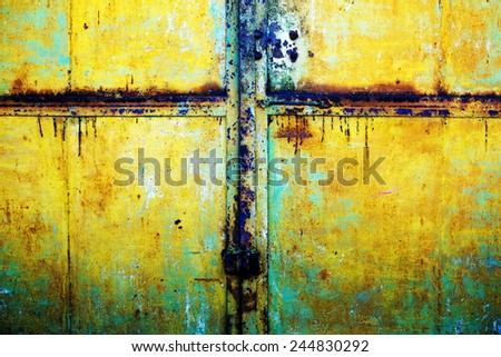 rusty metallic background with shabby and old paint from time to time - stock photo