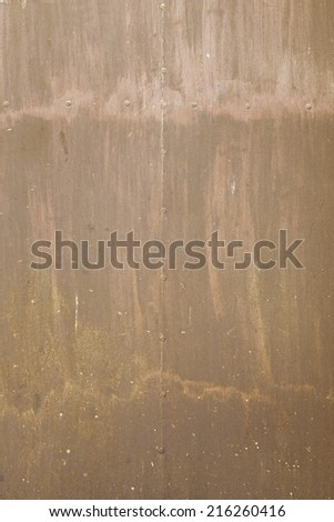 Rusty metallic background with texture, detail of a wall in disrepair, rusty metal - stock photo