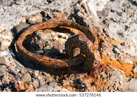 Rusty mooring ring for tying ships or boats on the the quayside of the port of Portofino. Liguria, Italy
