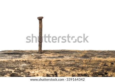 Rusty nails and old wooden white background. - stock photo