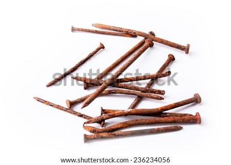 rusty nails on white background. - stock photo