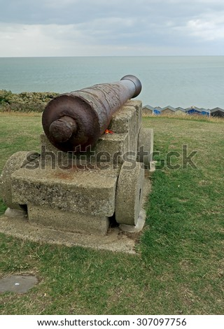 Rusty old canon overlooking Tenderton beach / Rusty old canon at Tenderton - stock photo