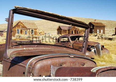 Rusty old cars in a ghost town in California. - stock photo