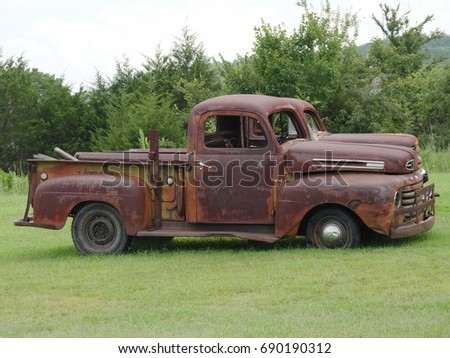 Rusty Old Pickup Truck With Shattered Windshield Parked In A Grassy Patch Side View
