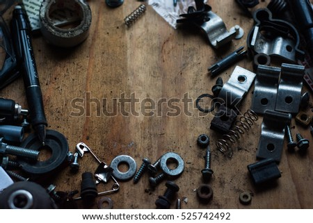 Rusty old screws, bolts, nuts etc on a piece of wood