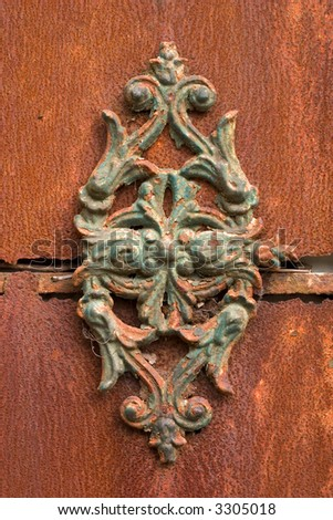 rusty ornament attached to an even rustier door