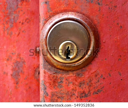 rusty red door key hole - stock photo