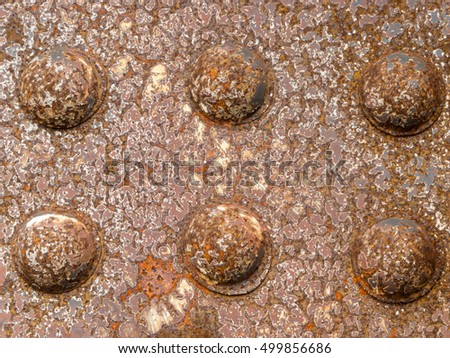 Rusty rivets of grungy iron steel construction background texture pattern