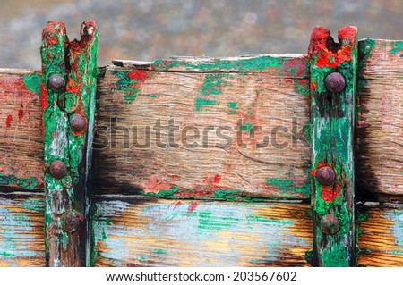 rusty rivets on old and cracked wooden boat - stock photo